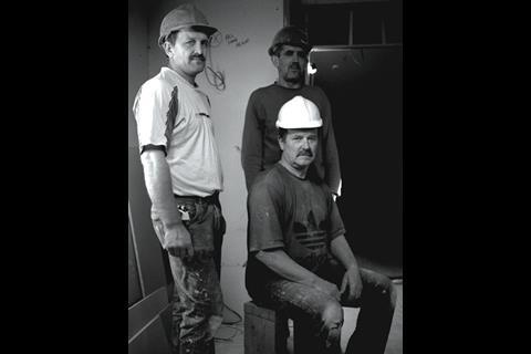 Jozef Sadley (sitting), 55, is a bricklayer from Warsaw.